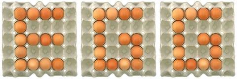 Parola dell'UOVO dalle uova in vassoio Fotografia Stock