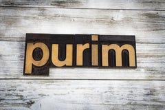 Parola dello scritto tipografico di Purim su fondo di legno Fotografia Stock
