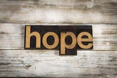 Parola dello scritto tipografico di speranza su fondo di legno Fotografie Stock Libere da Diritti