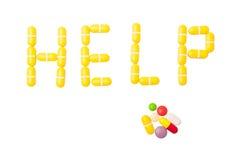 Parola di aiuto fatta con le pillole Fotografia Stock
