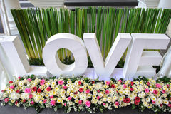 Parola di amore per il contesto di nozze Fotografia Stock