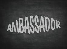Parola di concetto di ambasciatore su un fondo della lavagna fotografia stock libera da diritti