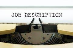 Parola di descrizione del lavoro scritta su una macchina da scrivere d'annata gialla Concetto di affari fotografie stock