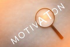 Parola di motivazione con la lente jpg Fotografie Stock Libere da Diritti