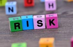 Parola di rischio sulla tavola fotografie stock libere da diritti