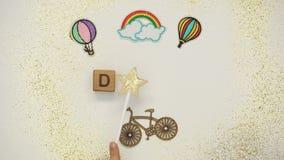 Parola di sogno sui cubi fatti dal bambino con la bacchetta magica, infanzia felice, carità video d archivio
