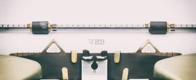 Parola di WEB in lettere maiuscole su una macchina da scrivere Fotografia Stock Libera da Diritti