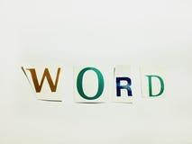 Parola - il ritaglio esprime il collage delle lettere miste della rivista con fondo bianco immagini stock libere da diritti