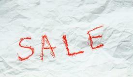 Parola rossa di vendita su Libro Bianco Immagine Stock