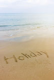 Parola scritta nella spiaggia Fotografia Stock