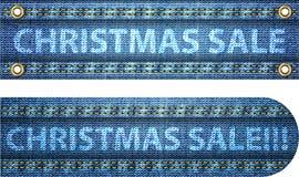 Parole di vendita di natale sulla priorità bassa delle blue jeans Fotografia Stock