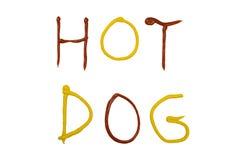 parole HOT DOG scritti con salsa ketchup e senape Immagini Stock Libere da Diritti