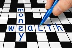Parole incrociate - ricchezza e soldi Fotografia Stock Libera da Diritti