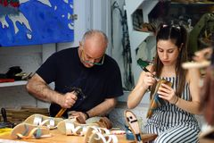 PAROS, GREECE, 18 2018 Artisans of the shoe at work in the center of Parikia stock image