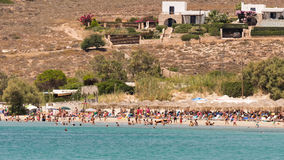 Paros, Greece, 10 August 2015. Local people and tourists enjoying their summer vacations at famous Marchello beach in Paros island Royalty Free Stock Photography