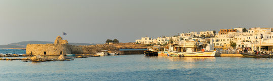 Paros, Greece 5 August 2016. Panoramic view of Naoussa local village with Kastelli castle. Royalty Free Stock Photo