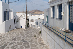 Paros, Greece, 15 August 2015. Stoned traditional alley at Paros island in Greece in the morning. Royalty Free Stock Photography