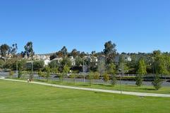 Parque da rua das casas de árvores Fotos de Stock Royalty Free