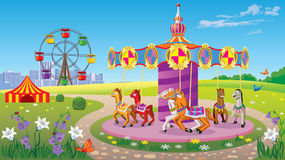Parque de atracciones para los niños, con el carrusel con los caballos Foto de archivo libre de regalías
