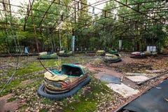 Parque de diversões em Pripyat zona de exclusão da cidade do fantasma de Chernobyl Imagem de Stock