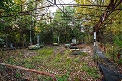 Parque de diversões em Pripyat zona de exclusão da cidade do fantasma de Chernobyl Fotos de Stock