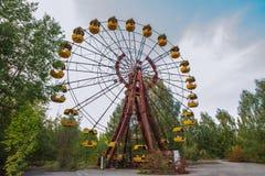 Parque de diversões em Pripyat zona de exclusão da cidade do fantasma de Chernobyl Imagens de Stock Royalty Free