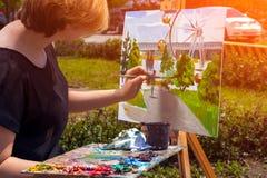 Parque del verano de la pintura del artista imágenes de archivo libres de regalías