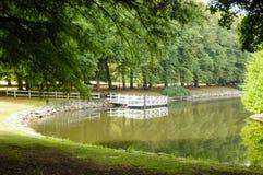 Parque e rio quietos Fotografia de Stock Royalty Free