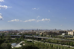Parque Lineal del Manzanares, Madrid. Panorama view of Madrid's skyline from the quiet green Parque Lineal del Manzanares, a public park along Manzanares River Stock Images