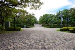 Parque público o jardín para el uso del fondo Imagenes de archivo