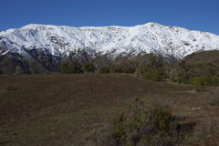 Parque Puente Nilhue, Santiago, Chile. Snow covered mountains in Parque Puente Nilhue in the foothills of the Andes Mountains surrounding Santiago, capital of Stock Images