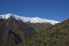Parque Puente Nilhue, Santiago, Chile. Snow covered mountains in Parque Puente Nilhue in the foothills of the Andes Mountains surrounding Santiago, capital of Royalty Free Stock Photography