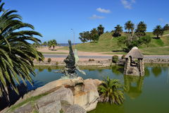 Parque Rodo, Montevideo. Small lake, ocean, and sculpture in the Rodo Park, Montevideo, Uruguay Royalty Free Stock Photography