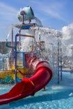 Parque, tobogán acuático y espray del agua Imagen de archivo libre de regalías
