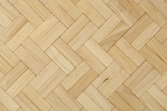 Parquet. Beech herring-bone pattern as background Stock Images