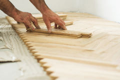 Parquet and carpenter concept Stock Photos