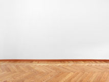 Parquet and empty white wall Stock Photo