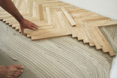 Parquet floor and carpenter stock photo
