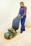 Parquet Floor maintenance by grinding machine Stock Photos