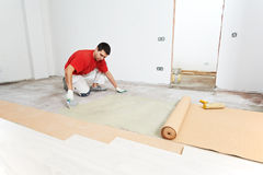 Parquet Floor work with cork layer Stock Images