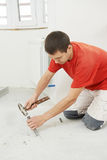 Parquet Floor worker with hammer Stock Photos