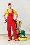 Parquet floor worker with polishing machine Stock Images