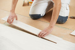 Parquet Floor worker with wood board Royalty Free Stock Photos