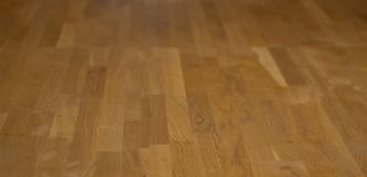 Parquet flooring is arranged in a long and clean line.Vertical Parquet Flooring . Wood laminate parquet floor texture room stock photos