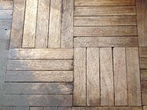 Parquet pattern. Wooden texture of parquet pattern brownish red close up background Royalty Free Stock Photos