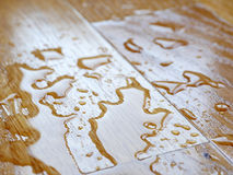 Parquet. Water drops on wooden surface. Stock Images