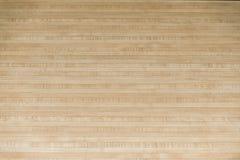 Parquet wood floor black arrows of bowling sport stock images