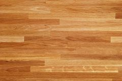 Parquet wood texture, dark wooden floor background royalty free stock images