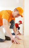 Parquet workers at flooring work Stock Photos