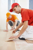 Parquet workers at flooring work Royalty Free Stock Photos
